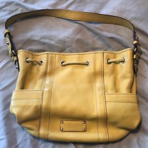 Tignanello mustard yellow leather bucket bag